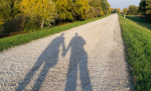 Shadow of a Couple on the Dirt Road in the Nature